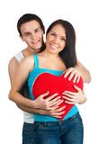 Young couple with a heart Royalty Free Stock Photo
