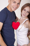 Young couple with a heart. Young couple sharing a heart Stock Image