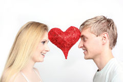 Young couple with heart Royalty Free Stock Images