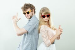 Couple man and woman making gun gesture. Royalty Free Stock Photo