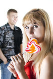 Young couple with heart-shaped lollypop Royalty Free Stock Image