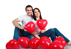 Young couple with a hearts Royalty Free Stock Images