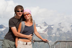 Young couple high in the mountains Royalty Free Stock Photos
