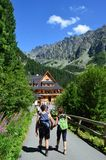 A young couple of hiker on a hike in the mountains. Popradske Pleso mountain Lake in the High Tatras, Slovakia, Europe royalty free stock photos