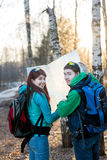 Young couple hikers looking at map. Stock Images