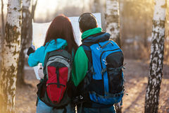 Young couple hikers looking at map. Stock Image