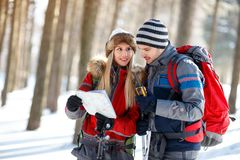 Couple of hikers orienting themselves with map Royalty Free Stock Images