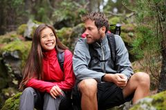 Young couple hiking. Hiking couple. Young people hikers having fun outdoors in forest. From La Caldera, Aguamansa, La Orotava, Tenerife, The Canary Islands Royalty Free Stock Photography