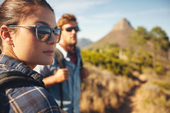 Young couple hiking in countryside Royalty Free Stock Photo