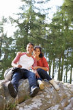 Young Couple Hiking Through Countryside Stock Photography