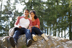 Young Couple Hiking Through Countryside Stock Images