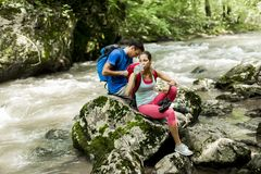 Young couple  hiking in the forest Stock Images