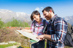 Young Couple Hiking Looking at Map Stock Photography