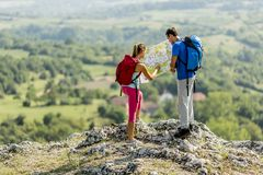 Young couple hiking on mountain Stock Photo