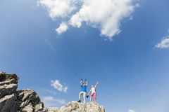 Young couple hiking on mountain Stock Images
