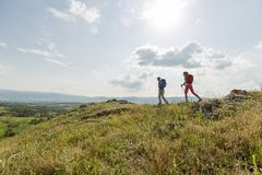 Young couple hiking on mountain Stock Photos