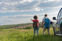 Young couple hiking on mountain. Adventure never ends. Young couple admiring view while out hiking during summer royalty free stock image