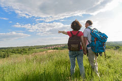 Young couple hiking on mountain royalty free stock image