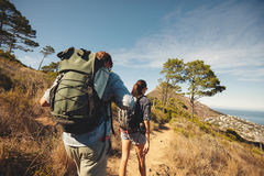 Young couple hiking in mountain Royalty Free Stock Image