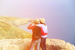 Young couple hiking in mountains looking at Stock Images