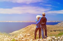 Young couple hiking in mountains looking at scenic Royalty Free Stock Images