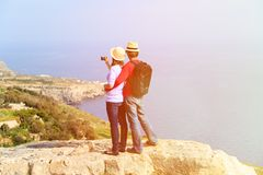 Young couple hiking in mountains making photo Stock Photos
