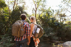 Young couple hiking outdoors Royalty Free Stock Images