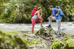 Young couple hiking by river Royalty Free Stock Photo