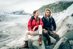 Young Couple Hiking In The Swiss Alps, Taking A Break Royalty Free Stock Photography