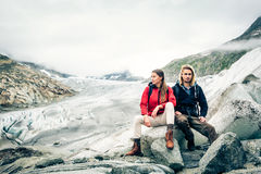 Young Couple Hiking In The Swiss Alps, Taking A Break Royalty Free Stock Photos