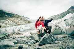Young Couple Hiking In The Swiss Alps, Taking A Selfie Royalty Free Stock Photos