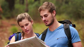 Young couple hiking together. In the beautiful outdoors stock footage