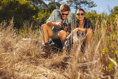 Young couple on hiking trip taking a break Stock Images