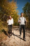 Young couple hikino on a warm autumn afternoon in nature. Young couple hiking on a warm autumn afternoon in nature Stock Photo