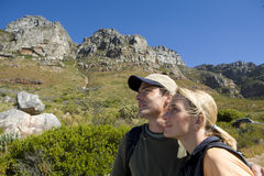 Young couple hiking in wilderness, side view Royalty Free Stock Photography