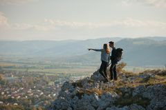 Young couple hikino on a warm autumn afternoon in nature Stock Photography