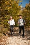 Young couple hikino on a warm autumn afternoon in nature.  Royalty Free Stock Photo