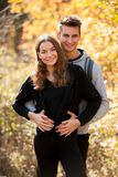 Young couple hikino on a warm autumn afternoon in nature.  Royalty Free Stock Images