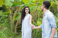 Young Couple Hispanic Man And Woman Walking Tropical Forest Holiday Happy Smiling Summer Vacation. Travel Stock Photos