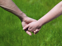 Young couple hold each other's hand Royalty Free Stock Photo