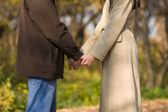 Young couple hold hands Stock Image