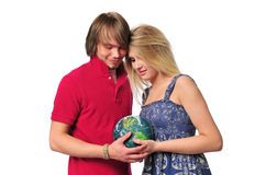 Young couple holdind the earth Royalty Free Stock Photography