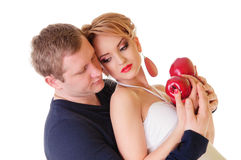 Young couple holding apples Royalty Free Stock Photo