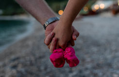 Young couple holding baby shoes.  Royalty Free Stock Photos