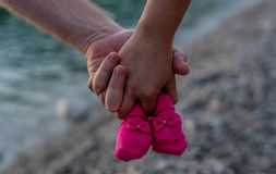 Young couple holding baby shoes.  Royalty Free Stock Photography