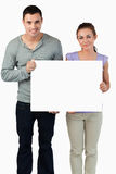 Young couple holding banner together Royalty Free Stock Image