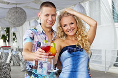 Young couple holding beverages Stock Images