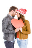 Young couple holding big heart Stock Photography