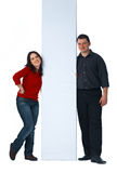 Young Couple Holding A Billboard Royalty Free Stock Image