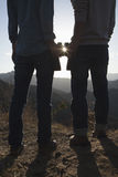 Young couple holding binoculars and looking at the sun Royalty Free Stock Photos